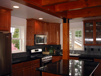 Exceptionnel Design In Cherry And Granite (Seattle, 2006) In A New House, This Kitchen  Has Cherry Cabinetry, Rough Hewn Granite Tile Backsplash, Stainless Steel  ...